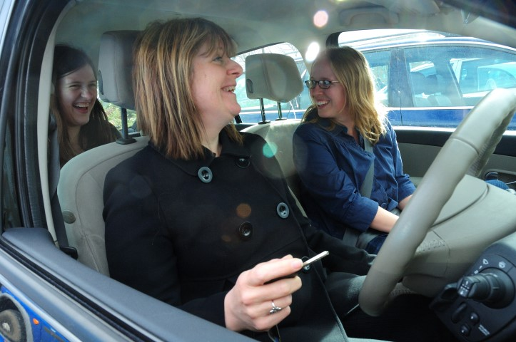 photo of 3 women car sharing